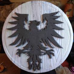 Pinned on foam cut out being sized. The final version on this shield has additional sculpture added under the wings.