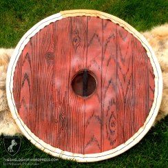 Woodgrain detail on a punch shield back