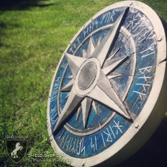 """The runes say """"Dad, Thanks for having my back, now here is something for yours - B"""""""