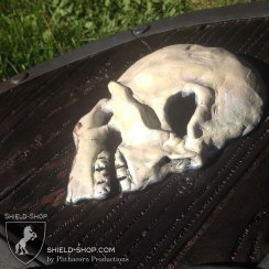 """Detail of a hand-sculpted skull on our """"Two Skulls"""" shield."""